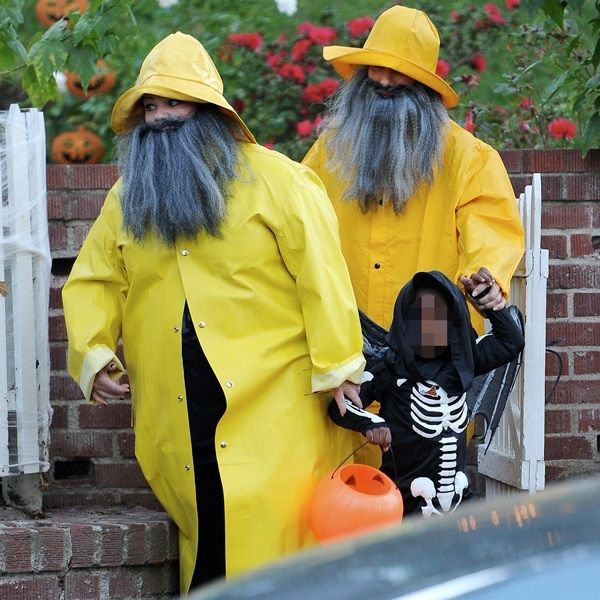 Actress Sandra Bullock out trick or treating with good friend Melissa McCarthy and their kids (The Heatactresses both wore bright yellow raincoat costumes with manly long beards; Sandra's son Louis wore a skeleton costume with wings, while Melissa's daughters Vivian and Georgette both wore little monster costumes and dad Ben Falcone as a Cat Burglar)in Burbank, California,on October 31, 2013