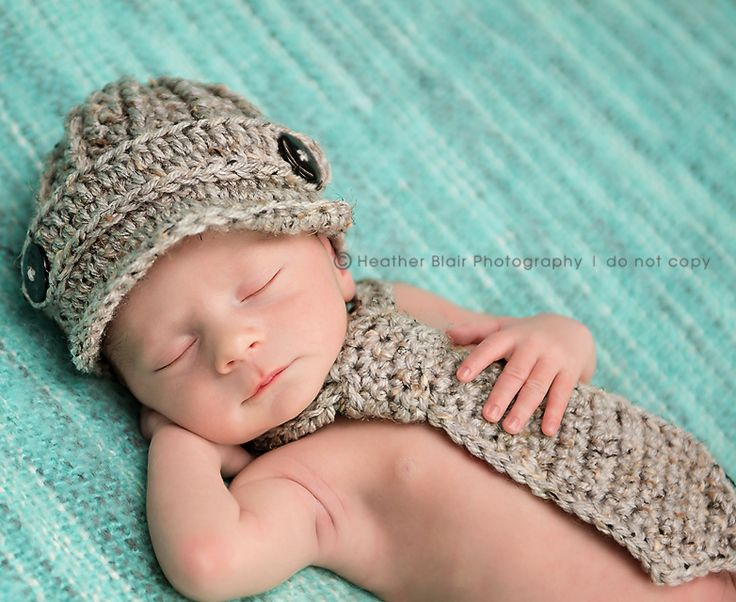 Crochet baby hat and necktie. I don't know about the tie - but the hat is ADORABLE!!