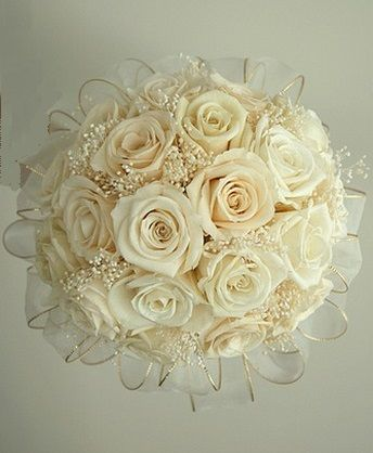 Ivory Rose Bridal Bouquet with ribbon boarder and baby's breath.