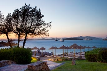 Hotel Pitrizza, Costa Smeralda. A private beach, granite pool, premier restaurant, and more combine with native décor for an exclusive and authentic Costa Smeralda stay