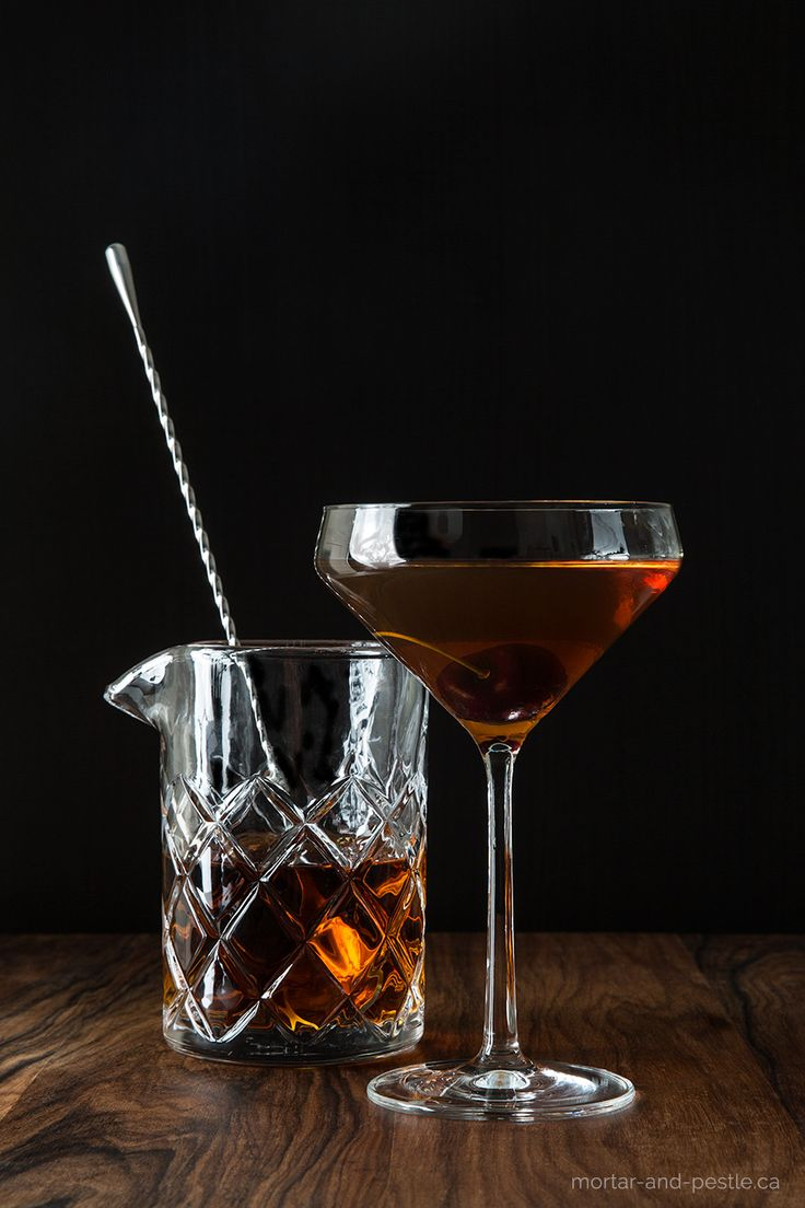 A Mexican ancho chile liqueur and homemade cocktail cherries put a spicy, smoky spin on the classic Manhattan.