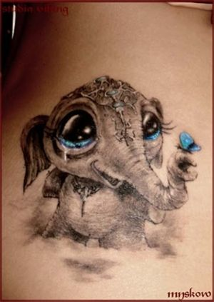 Elephant-- I just adore this tatt...the detail is awesome and I love how the only color used is the beautiful baby blue...