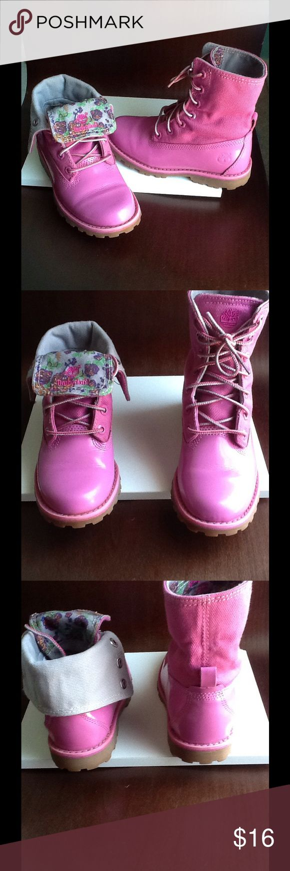 Girls Timberland boot So cute! Can be worn laced up as combat boot or turned down,when turned down shows inside gray canvas and floral tong w/timberland logo,just like new Timberland Shoes Boots
