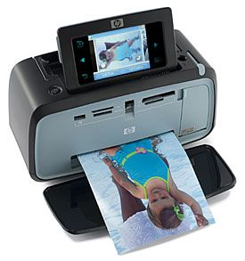 HP Photosmart A636 Compact Photo Printer Review & Rating | PCMag.com - the perfect portable printer for art journaling retreats.