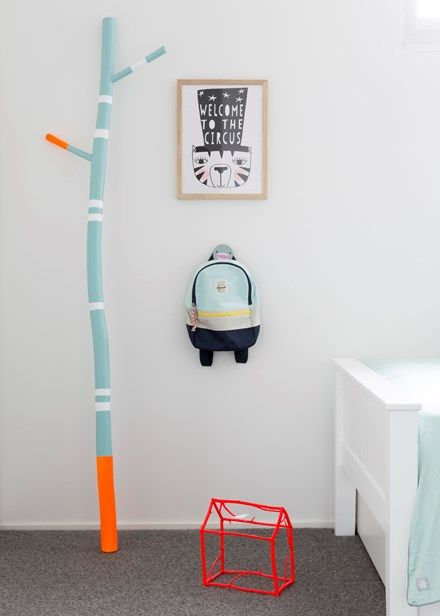 Adding a few bursts of colour helps items stand out, while low hooks keep things tidy yet within reach | Home Beautiful Magazine Australia