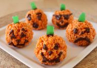 Pumpkin Rice Crispy Treats:  Nix the stupid faces, and maybe do a mini rolo or tootsie roll for the stem and then a icing or fondant leaf or two on top to seal the deal and these would be perfect for Thanksgiving.