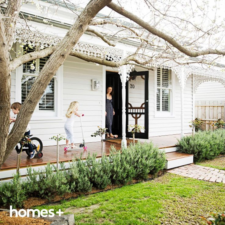 The classic white exterior of Claire's Victorian cottage is complemented by neat hedging and a beautifully finished timber porch. As featured in the December 2014 issue of homes+. #streetappeal #frontyard #garden #entrance #homesplusmag