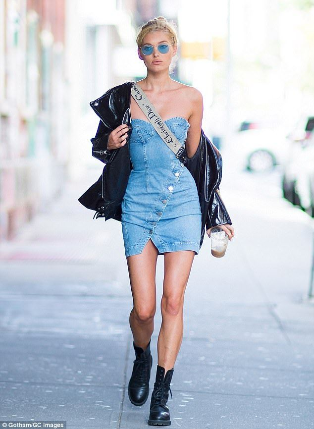 Elsa Hosk flaunts slim figure in denim bustier mini-dress in NYC