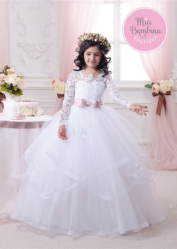 This flouncy ruffled dress features long lace sleeves, scalloped lace neckline, and a lace-up corset back. Two bows at front and back accentuate the waist. Cascading ruffles add more fullness to the m