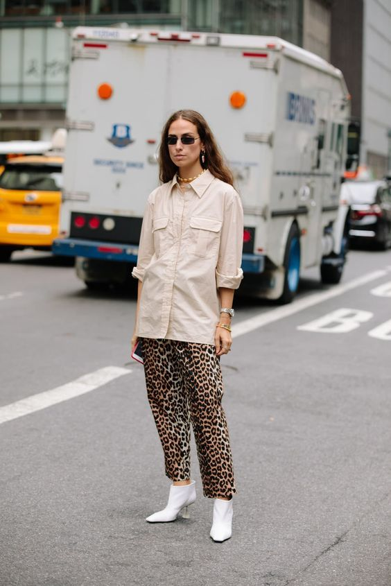b6ac6c5ec185 Leopard Outfits Trends to Keep in 2019 Classic Print Leopard Pants White  Booties Safari Button Down Shirt Utility Shirt Utility Trend Street Style