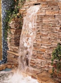 "Along with the rain tile, the master bathroom shower would have something like this Kohler BodySpa Waterfall.  Except maybe the slightest bit less ""natural"" looking...I'm sure I'd whack my head on those rocks."