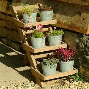 Garden Ideas With Wood relaxed wood pallet outdoor garden ideas Garden Storage Ideas Wooden Herb Pot Stand From Garden Trading Could Make One