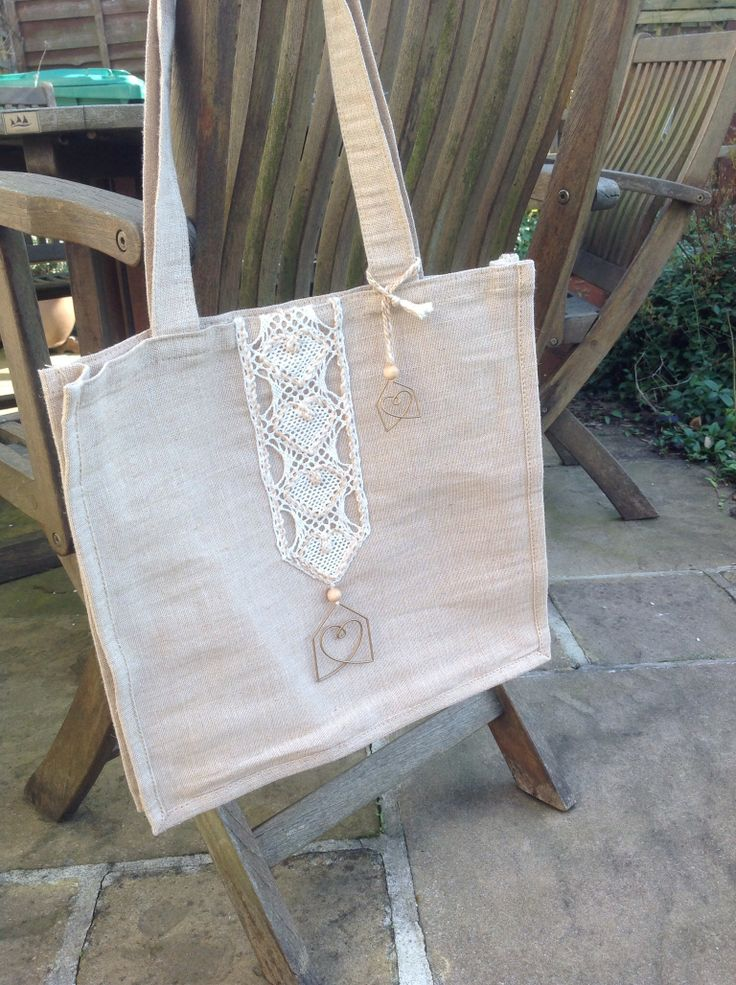 Lace design inspired by the shape of unusual paperclip bought in 'Habitat' - example hanging on bag.
