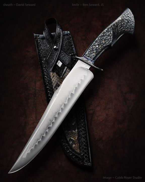 Ben Seward custom Bowie Knife. 1075 steel, Carbon Fiber handle, damascus guard. Look at that long, sweeping harpoon swedge and hamon line. Amazing work. The guy's an artiste.