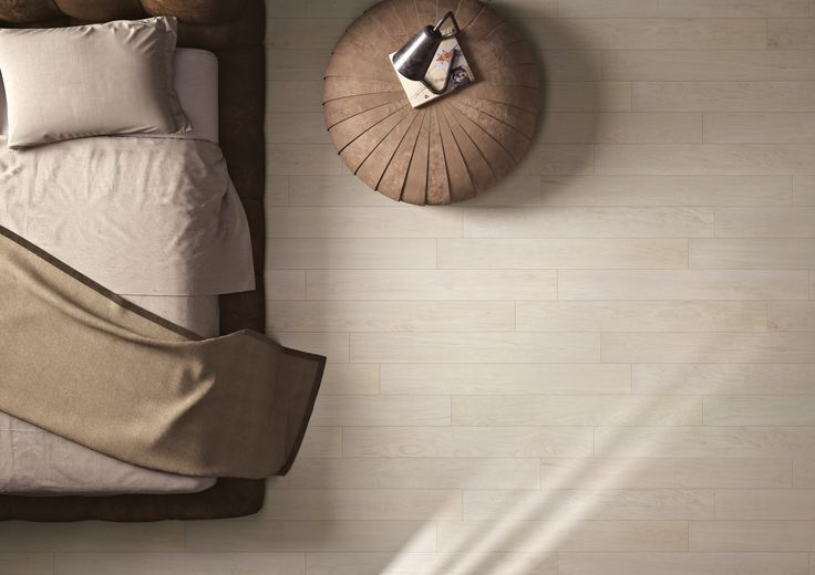 Timber look porcelain tiles in the bedroom. No more allergens!