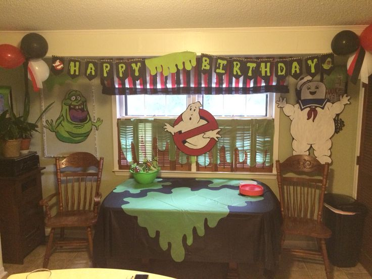 Curtain cover made with streamers, green slime was made by cutting a green plastic table cover, hand painted decorations on brown packaging paper