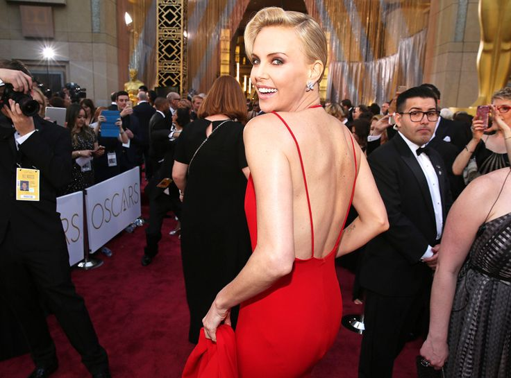 Charlize Theron from Oscars 2016 Candid Moments  The actress channels old school Hollywood glam in this Christian Dior gown.