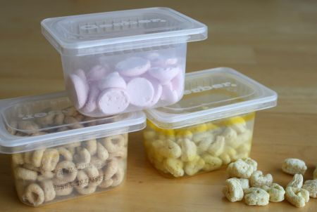 Recycle baby food containers for snacks portions later that won't crush in the car or purse (also...the glass jar type is always good for sorting nails or screws in the garage & you can paint the lids so no one really knows what you're reusing...)