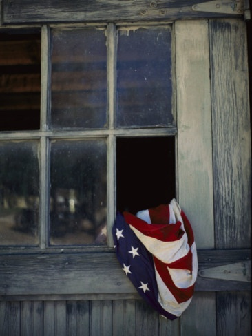 An American Flag Lies Loosely Bunched in an Open Window Photographic Print