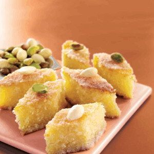 Basbousa... Fantastically easy dessert recipe that is perfect with coffee or tea to end a big meal. Great for serving at a gathering or party.