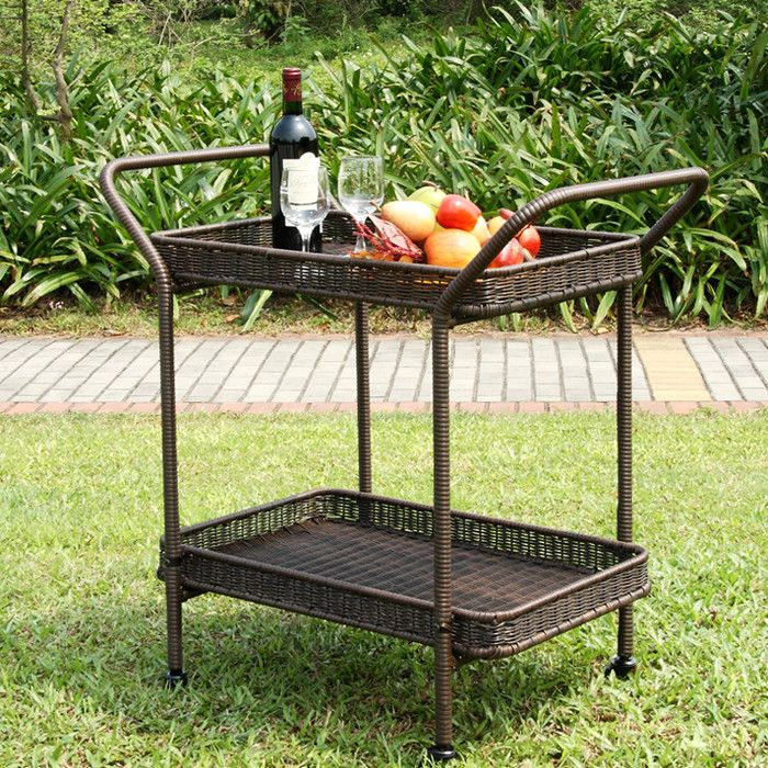 Complete your serveware set in simple style with the understated Petherton Serving Cart, featuring a 2-tiered wicker and rattan design, metal frame, and 2 handles. Set it in the den with stemware on top and liquor below to create a simple (and portable) home bar to complement a breezy, beach-chic ensemble. If your hosting a backyard gathering, just pull this design out onto the patio to serve up trays of finger food and glasses of sweet sangria. When the crowd is gone, treat this cart as a…