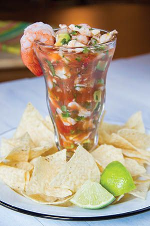 Mexican Seafood Cocktail: This zesty combination of shrimp cocktail and pico de gallo is perfect when paired with salty tortilla chips and a nice, cold beer.