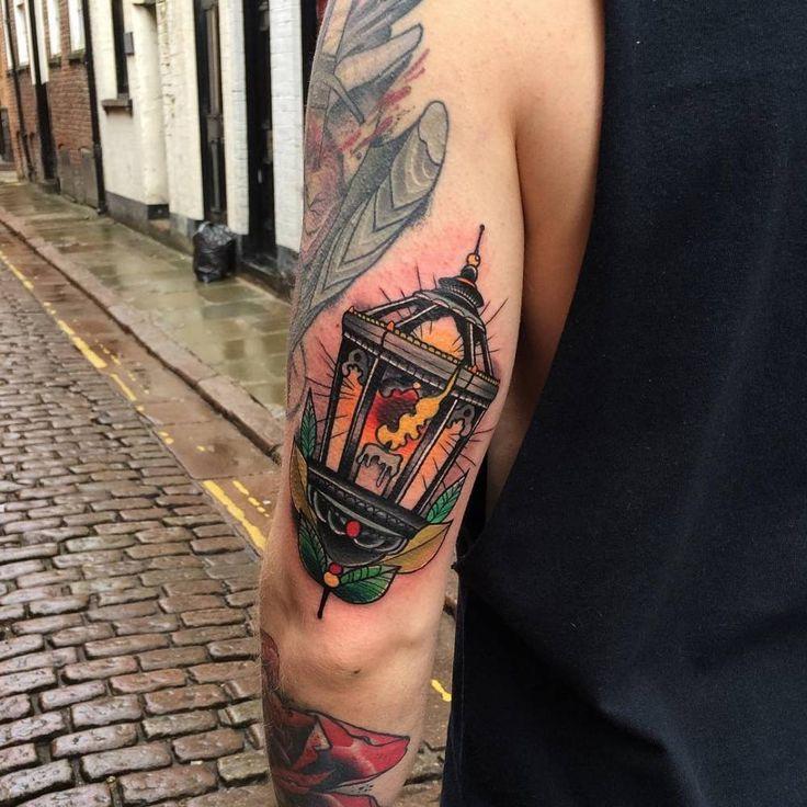 Neotraditional lantern tattoo on the left tricep. Tattoo Artist: Matt Webb