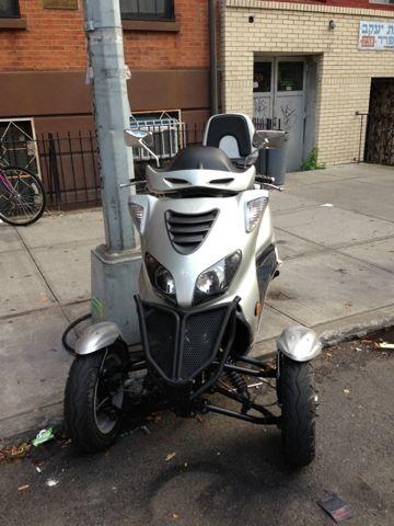 Weird, Can Am 3 Wheel Scooter?