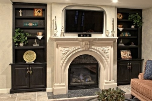 TV set into wall above fireplace
