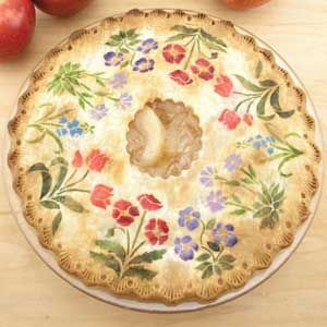 Anyone can do this one - all you need is a stencil and apply colored sugar or powdered sugar - food coloring 'paint' on your pie crust top then bake as usual.