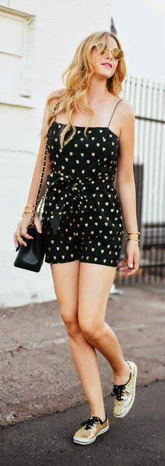 Adorable black hearts printed mini dress with black leather hand bag and gold braslates and cool goggles and golden soft shoes the best way ...