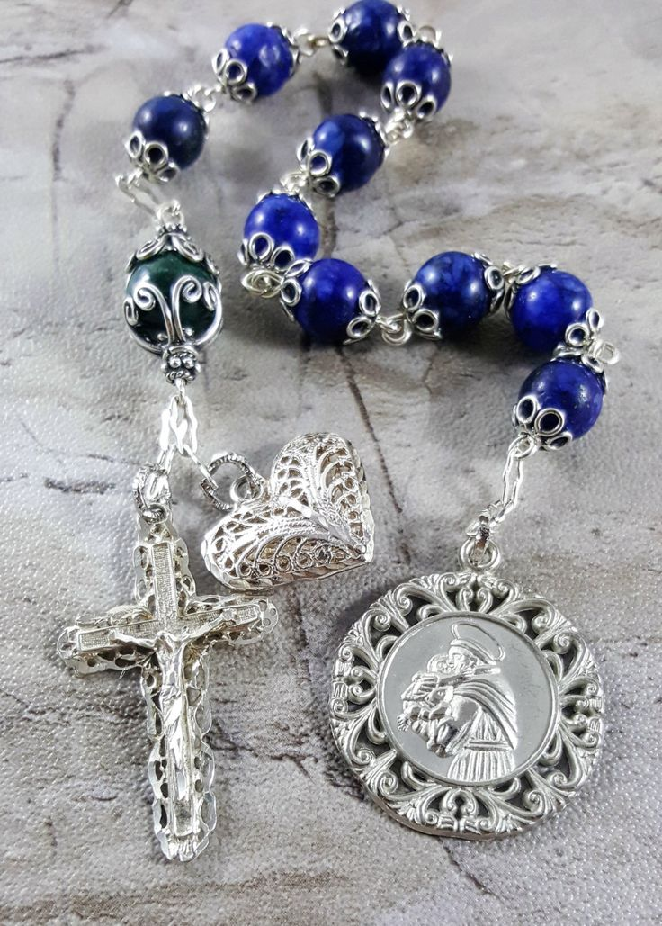 Sterling Silver Elderly Protection, and Healthy Pregnancy/ Childbirth Pocket Rosary Tenner Chaplet with Lapis Lazuli and Malachite  -Lapis Lazuli 8 mm Gemstone Ave Beads.  -Malachite 11 mm Our Father Bead.  - Sterling Silver Ornate Large 1 St Anthony Medal, Sterling Silver Ornate Filigree 1 3/8 Crucifix, Sterling silver large Filigree heart, and bali style caps and chain.  Lapis Lazuli - Stone of wisdom and protection, releases stress, allowing for peace and serenity. Malachite - De...