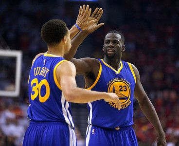 Description of . Golden State Warriors\' Draymond Green (23) high-fives Golden State Warriors\' Stephen Curry (30) after a play against the Houston Rockets in the second quarter of Game 3 of the NBA Western Conference finals at the Toyota Center in Houston, Texas, on Saturday, May 23, 2015.  (Nhat V. Meyer/Bay Area News Group)