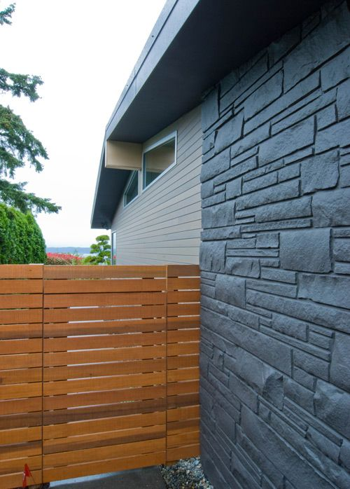 Fence.  And, the soffits are sheathed with MDO plywood and finished with Sherwin Williams paint. Perimeter soffits are painted dark to fade back in the shadow lines.