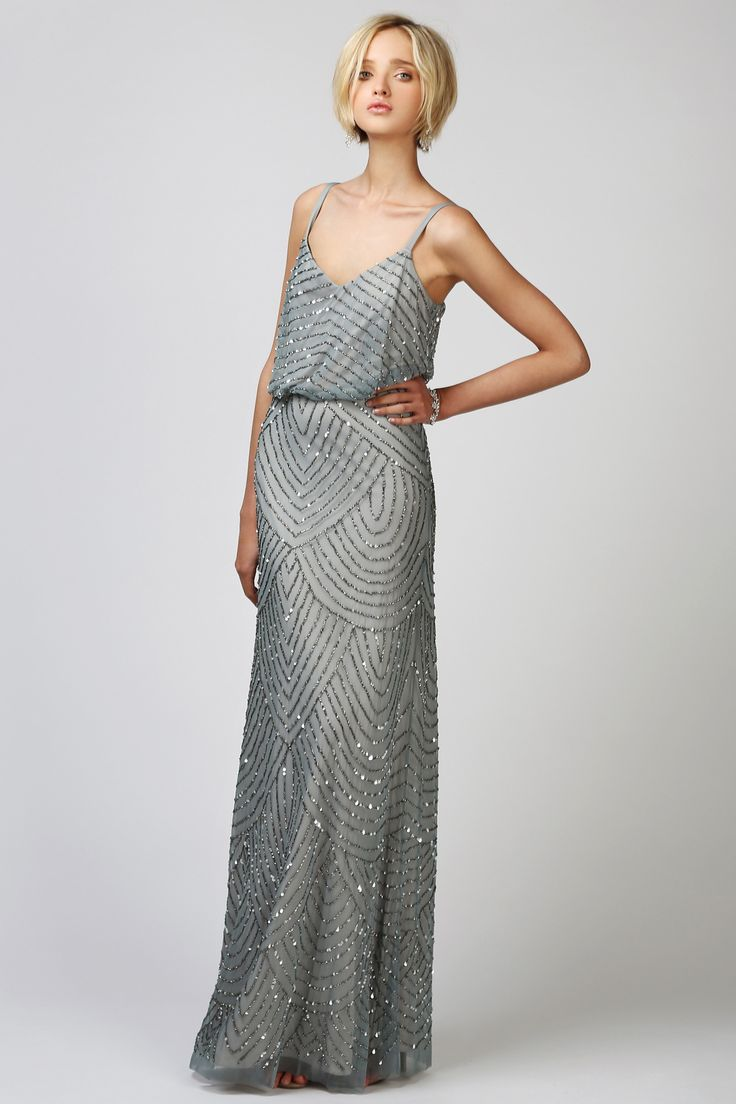 This beautiful Adrianna Papell Art Deco Sequin gown is the perfect embellished gown for your glamorous Bridal party. Style this stunning floor-length  beaded gown with your soft chiffon Joanna Augu...