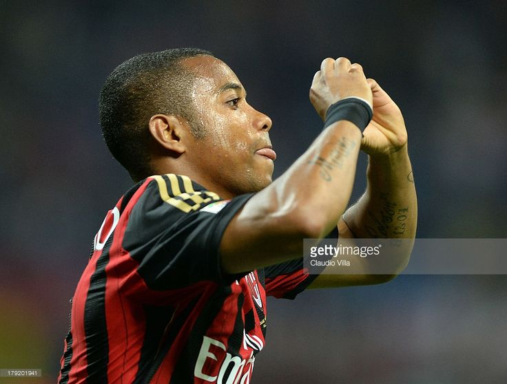 Robinho of AC Milan celebrates scoring the first goal during the Serie A match between AC Milan and Cagliari Calcio at San Siro Stadium on September 1, 2013 in Milan, Italy.