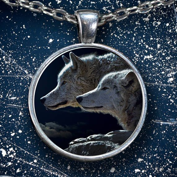 Wolf Necklace - Wolf Pendant - Two Wolves Profile Portrait  This Wolf Necklace shows two absolutely Gorgeous Wolves. These Wolves are very focused on something, maybe a predator; maybe pray; you be the judge.  **Wolf Pendant Necklace - Choice of Silver Plated or Gun Metal.  **This Wolf Necklace comes Silver plated Or Gun Metal with a clear glass cabochon that magnifies and protects the beautiful design underneath. Shows the highest quality color and vibrance in your necklace as possible…