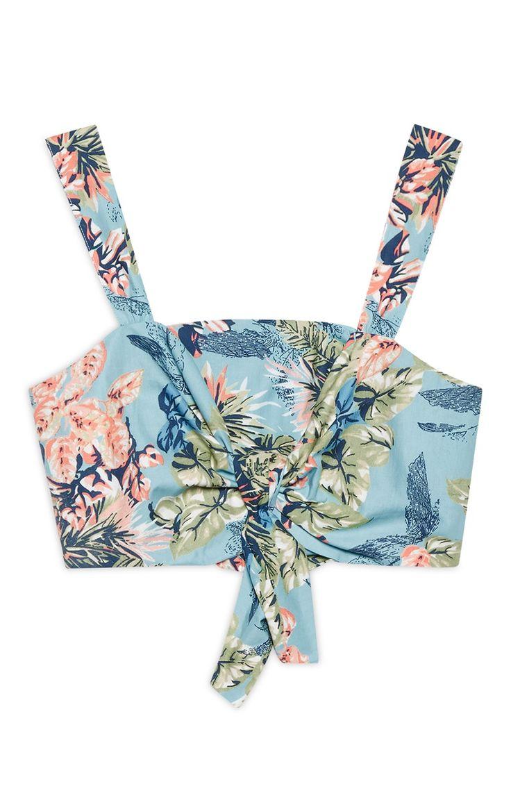 Blauw kort topje met bloemen en strik