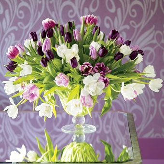 Tulips: Tulips come in almost every color you can imagine. For an airy, open arrangement, add white to a purply palette of feather and parrot tulips. Vase,  JamaliGarden.com.
