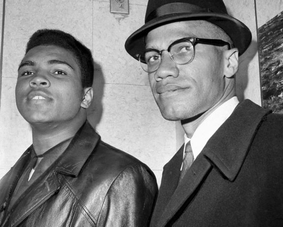 John Peodincuk/New York Daily News  Published: 03/19/2012 5:12:35  Cassius Clay and Malcolm X, 1964  Cassius Marcellus Clay with Malcolm X at 125th St. and 7th Avenue
