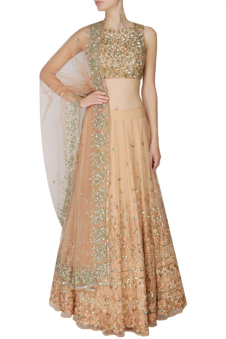 This set features a peach lehenga in net base with gold and peach thread and sequins floral work around the ghera. It has a can-can underlayer. It comes along w