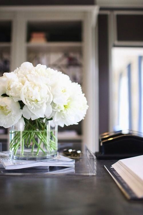 Interior design home office white peony flowers in vase, office desk, Lucite acrylic tray