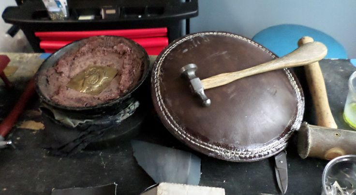 Metal working tools.  A jeweler's pitch bowl, a leather sandbag, hammers.  With these, you can do just about anything.  At Cowgirl Chile Co., Doylestown PA.