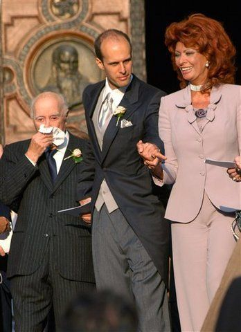 Sophia Loren and Carlo Ponti leaving the church after Carlo Jnr's wedding