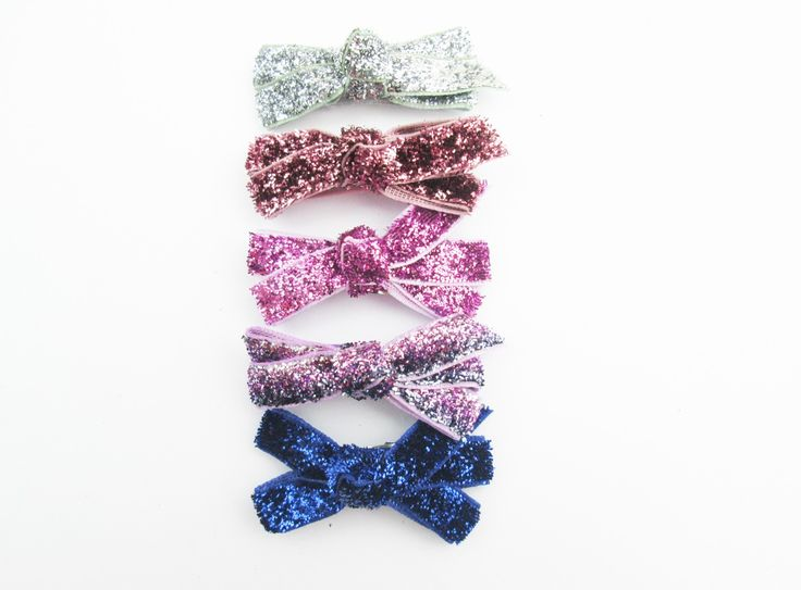 Sparkling glitter bows will add a little glitz to your little girl's outfit. #babyheadbands