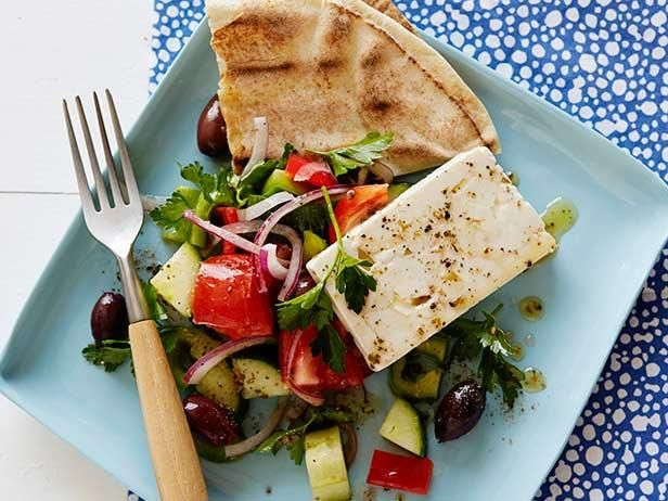 Make a restaurant-style Greek Salad at home; Rachael Ray loads her version with classic ingredients: kalamata olives, tomatoes, peppers and feta cheese.