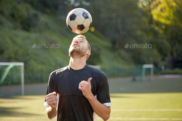 Soccer Player Playing With Ball On Field By Dolgachov Sport Football And People C Soccer Player Playing And Juggling Ball Using Header Techniqu In 2020 Soccer Players