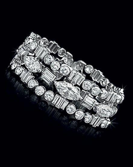 An Art Deco Diamond Bracelet, by Cartier                                                                                                                                                      More