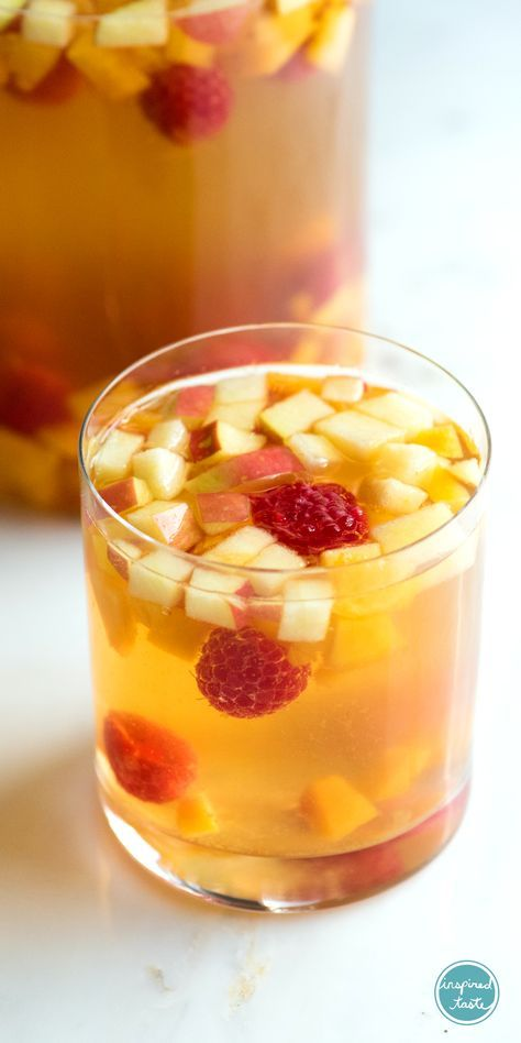 A fresh and fruity white sangria made with peaches, raspberries, vanilla, Moscato and Riesling. This sangria is almost too good.