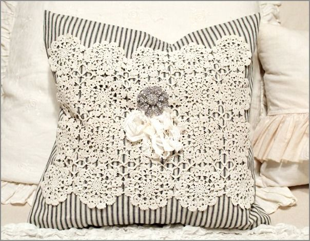 ticking pillow topped w/old lace & either old brooch or button! just one great idea for pieces of old lace. <3